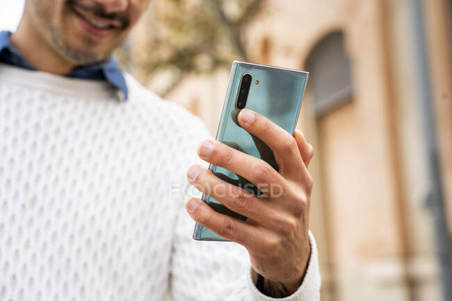 Businessman's hand holding smart phone — Stock Photo