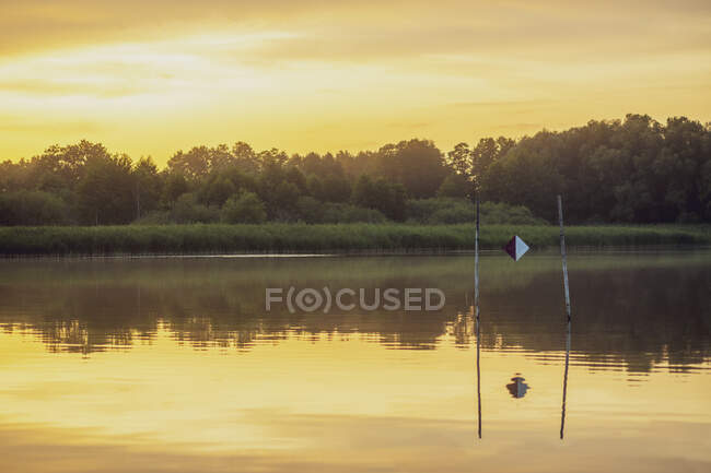 Reflection of dramatic sky in water during sunset — Stock Photo