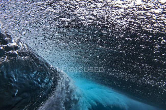 Underwater view of splashing sea wave — Stock Photo