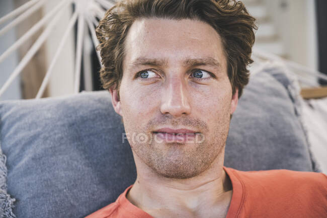 Close-up of man lying in hammock at home — Stock Photo