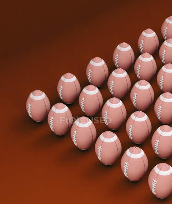 Регбі м'ячі на червоному фоні. — стокове фото