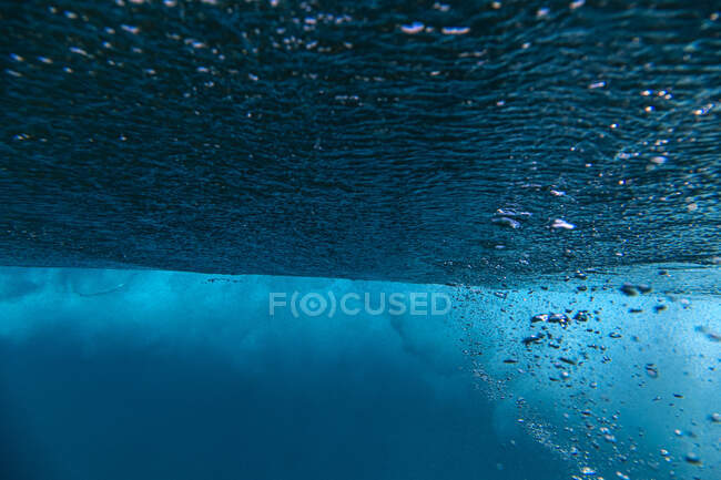 Undersea view of rising bubbles — Stock Photo