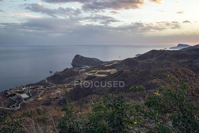 Grecia, Creta, Lentas, Veduta dalle colline costiere al tramonto — Foto stock
