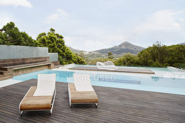 Swimming pool with deck chair — Stock Photo