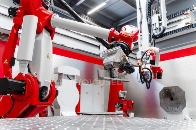 Robotic welding equipment in factory — стоковое фото
