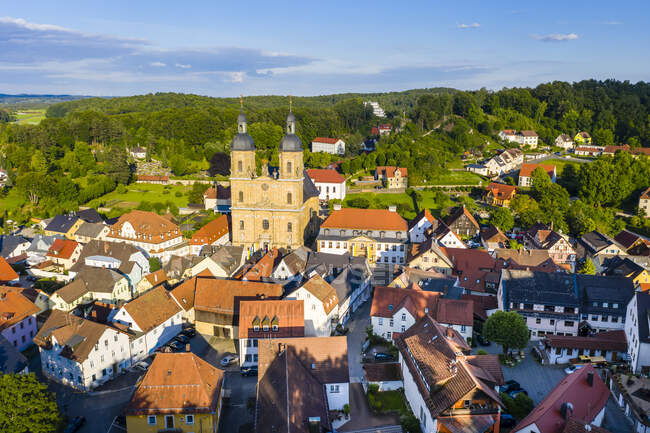 Germany, Bavaria, Gossweinstein, Aerial view of urban landscape with castle and church - foto de stock