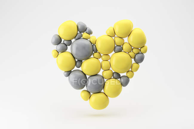 Three dimensional render of floating heart made of gray and yellow spheres — Stock Photo