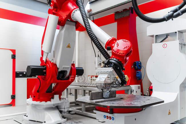Robotic welding machinery in factory — стоковое фото