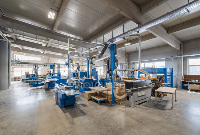 Manufacturing machinery in production hall at industry — стоковое фото