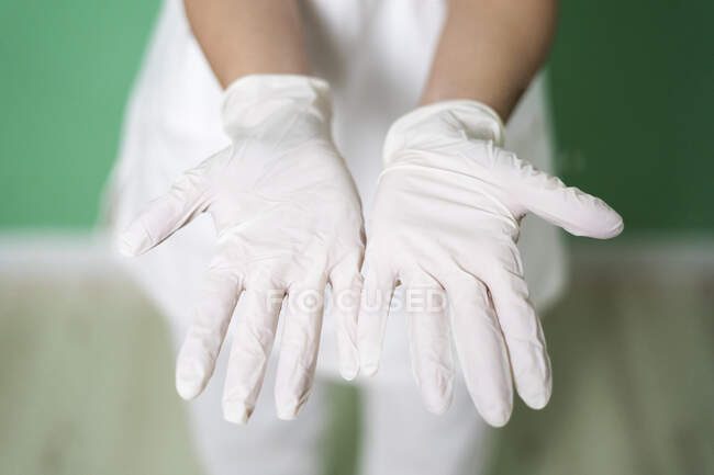Female doctor's hands wearing white glove — Stock Photo