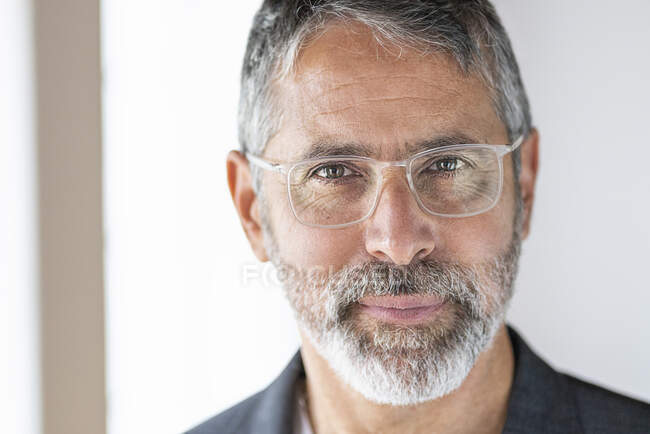Close-up of confident businessman staring while standing at home — Stock Photo