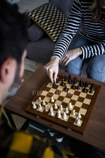 Woman and man playing chess at home — Stock Photo
