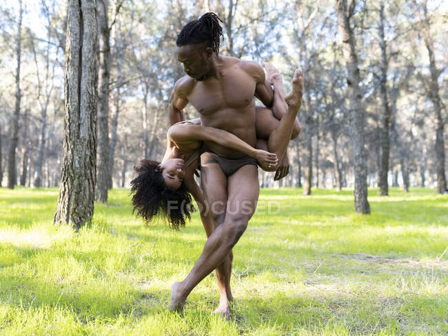 Two professional dancers performing in underwear in middle of forest — Stock Photo