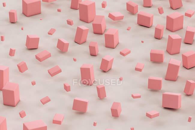 Three dimensional render of pink cuboids floating against gray background — Stock Photo