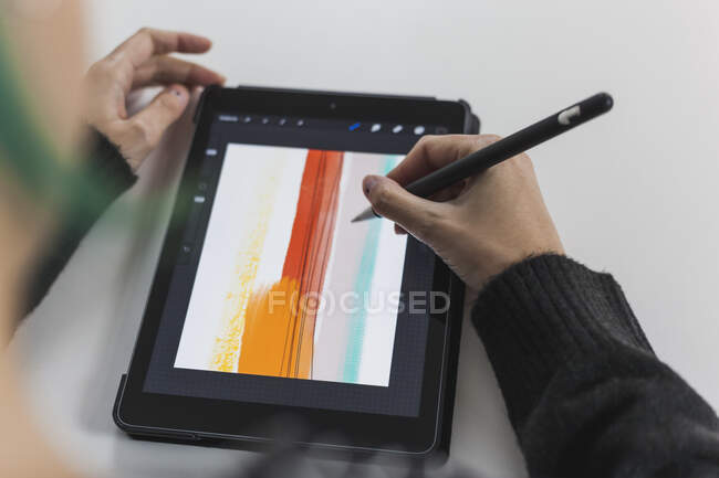 Female artist drawing with digitized pen on digital tablet — Stock Photo