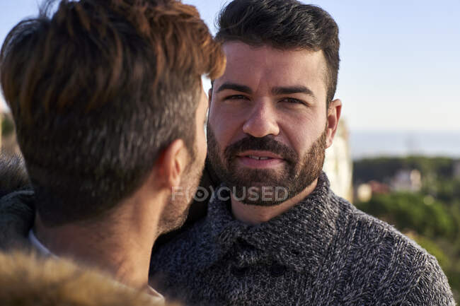 Close-up portrait of handsome man with boyfriend against clear sky — Stock Photo