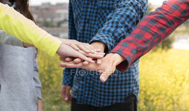 Male and female friends stacking hands — Stock Photo
