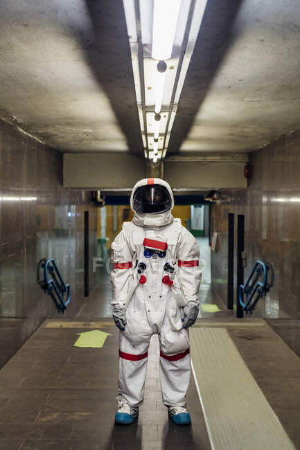 Male astronaut standing in basement — Stock Photo