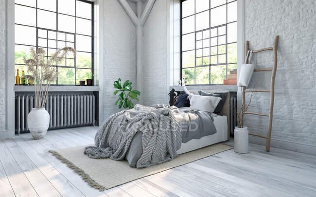 Одеяла на кровати в современных апартаментах — стоковое фото