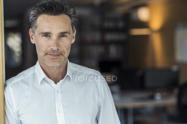 Confident mature businessman in office — Stock Photo