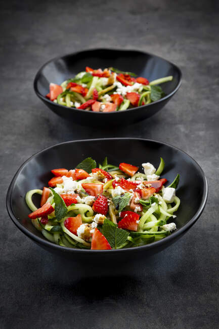 Two bowls of strawberry cucumber salad with feta, mint and balsamico vinegar — Stock Photo