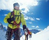 Front view of tourists group on snow mountain range — Stock Photo