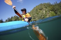 Surface shot of Man Kayaking In Mountain River — Stock Photo