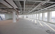 Interior of office hall under construction with unfinished ceiling — Stock Photo