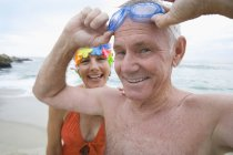 Portrait of mature woman in swimming costume and man with goggles — Stock Photo