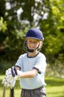 Front view of boy playing cricket — Stock Photo