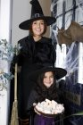 Mother and daughter dressed up as witches for Halloween — Stock Photo