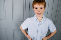 Indoor portrait boy with ginger hair — Stock Photo