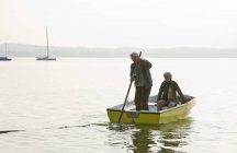 A senior couple in a rowing boat — Stock Photo