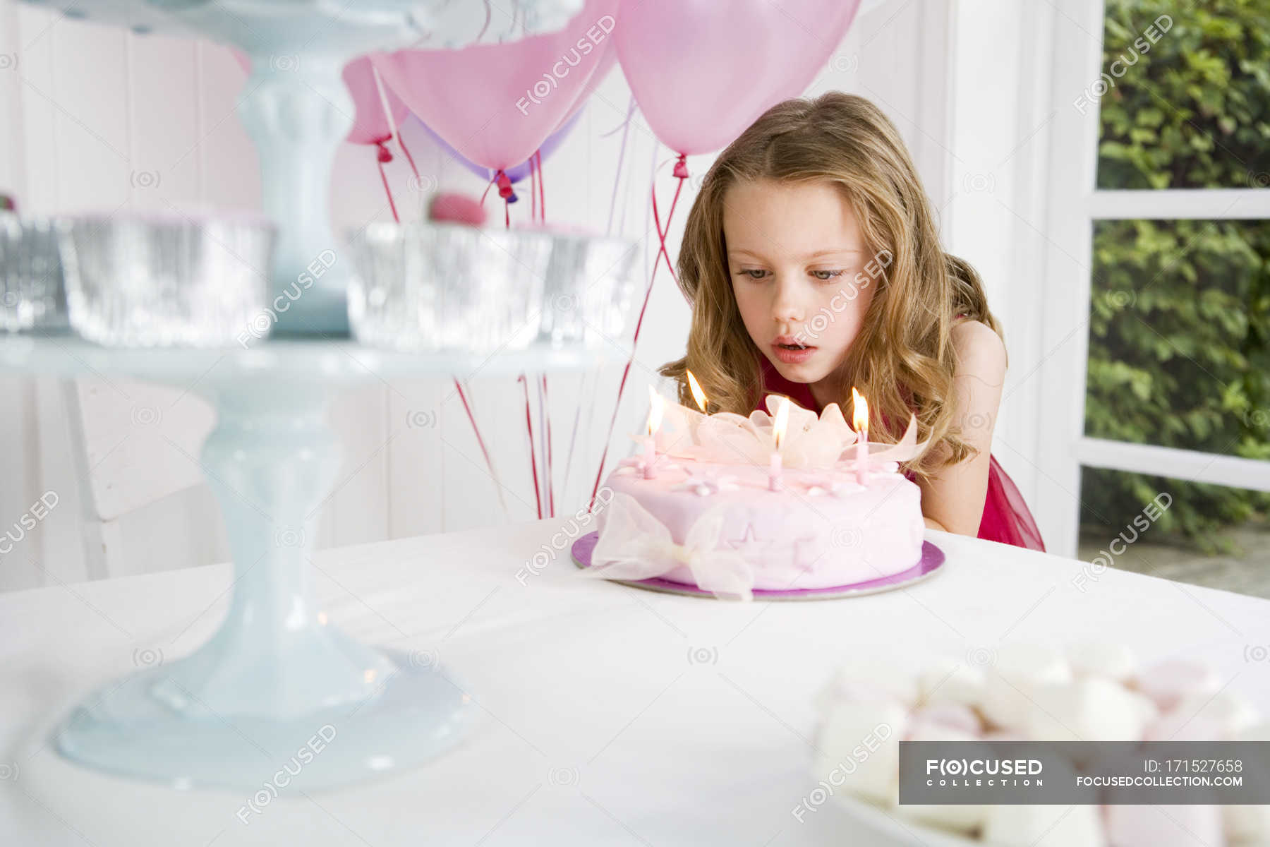 Girl Blowing Candles On Birthday Cake Selective Focus Facial