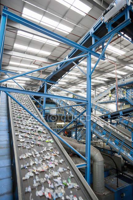 Plastic on conveyor belt — Stock Photo