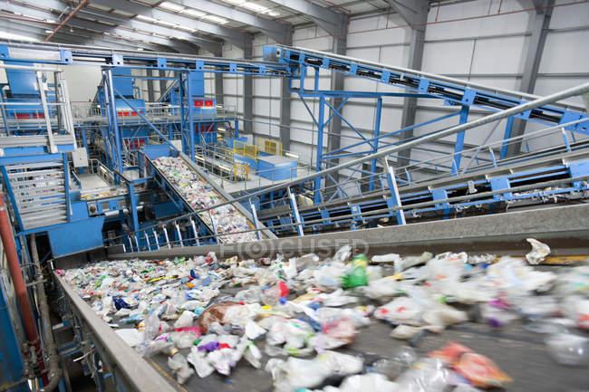 Plastic moving along conveyor belt — Stock Photo