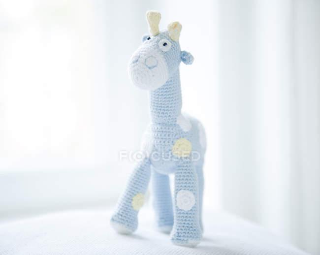 Close up view of handmade crochet giraffe doll toy — Stock Photo