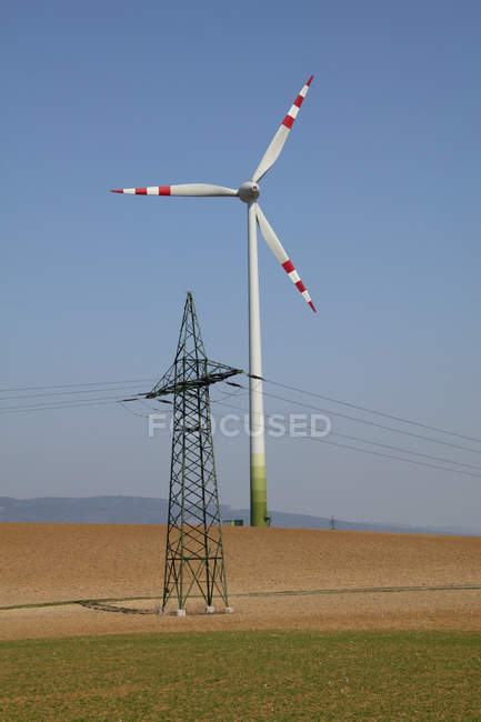 View of a wind engine and a power poll against blue sky, St. Poelten, Austria — Stock Photo