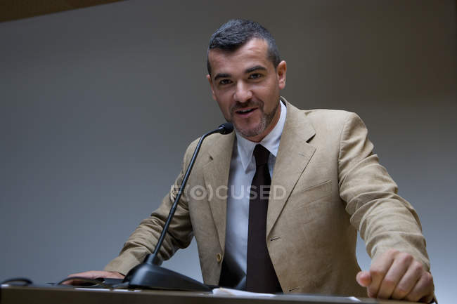 View of  businessman giving speech and looking at camera — Stock Photo