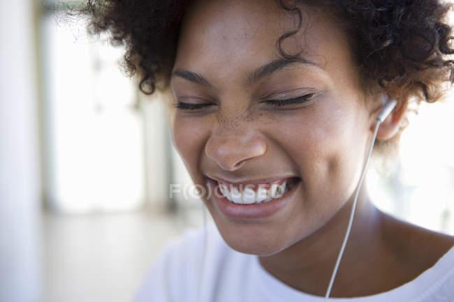 Woman leastening music — Stock Photo
