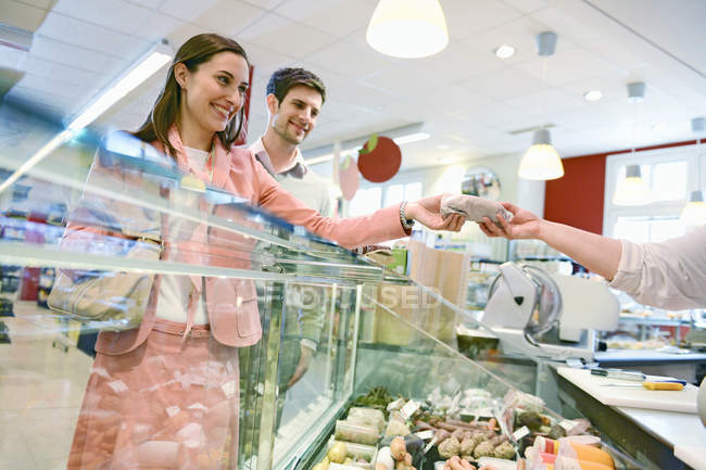 Customers shopping at the deli counter in organic grocery store — Stock Photo
