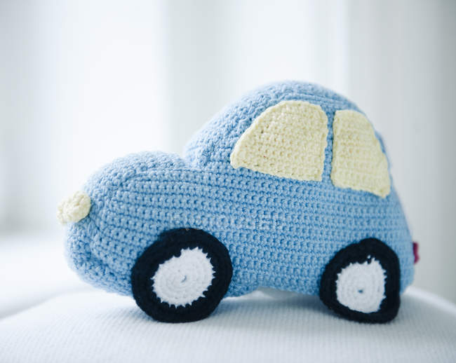 Close up view of handmade crochet car toy — Stock Photo