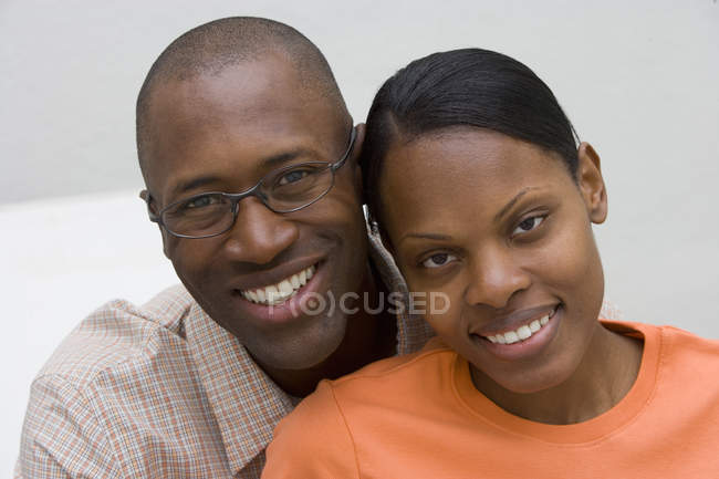 Rear view of couple smiling and looking at camera — Stock Photo