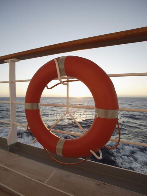 Life preserver on ship railing — Stock Photo