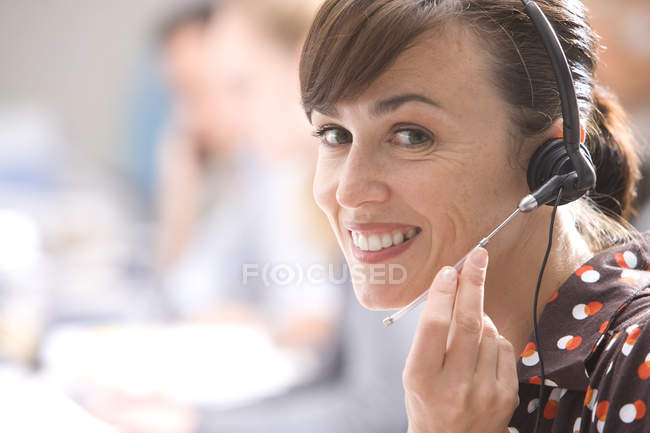 Smiling woman with headset — Stock Photo