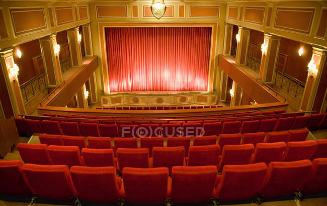 Balcony seating and stage in empty theater — стокове фото