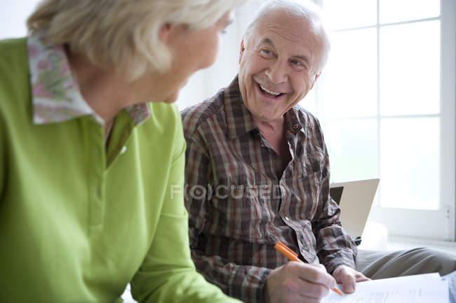 Senior man signing paperwork — Stock Photo