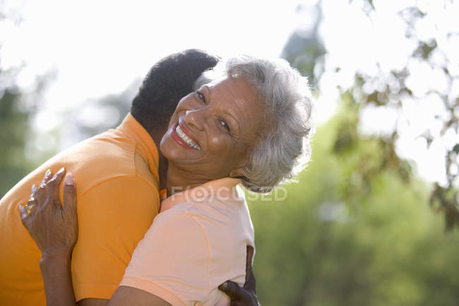 Front view of senior couple embracing outdoors — Stock Photo