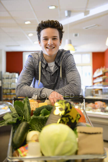 Teenage boy shopping in an organic grocery store, portrait — Stock Photo
