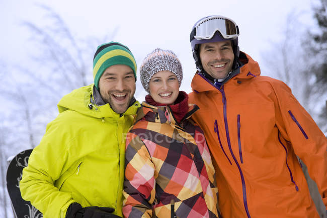 Front view of friends in warm clothing and woolly hats — Stock Photo